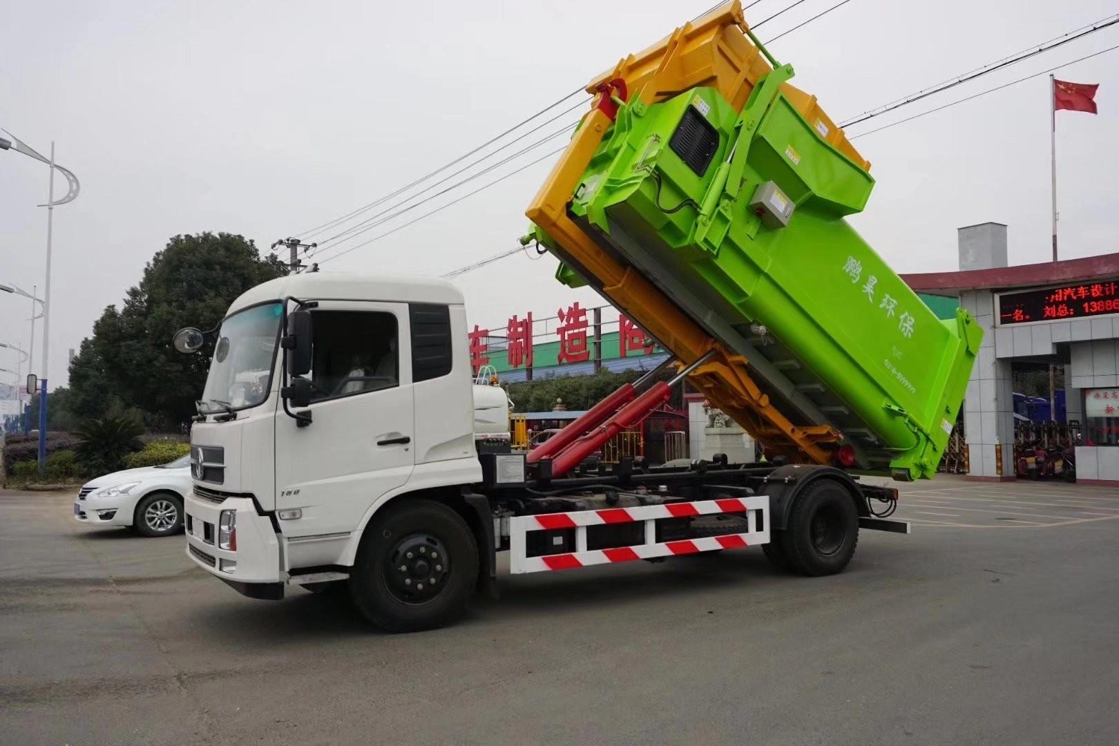 东风天锦12吨勾臂垃圾车图片