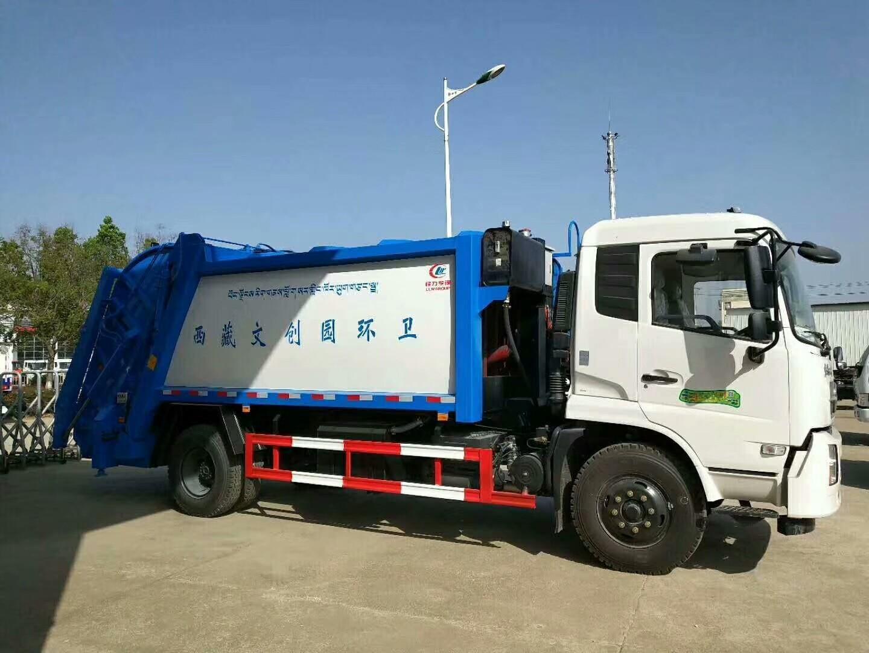 东风天锦15吨压缩带摆臂垃圾车图片