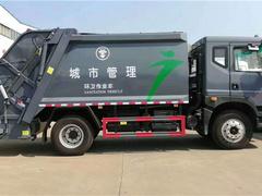 城市管理東風D9壓縮垃圾車發車