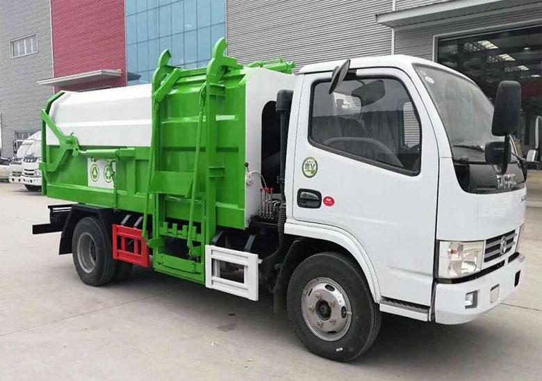 側裝壓縮垃圾車(東風小多利卡)