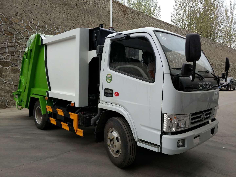 東風多利卡藍牌壓縮垃圾車圖片