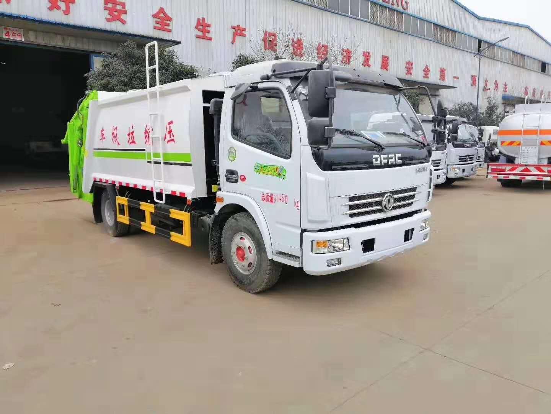 现车销售:2台东风多利卡系列8方压缩式垃圾车图片