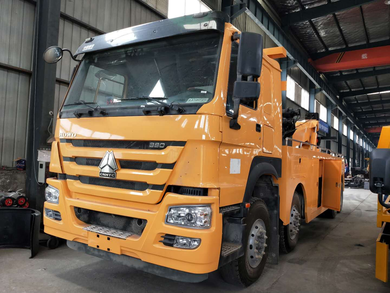 25吨上装重汽豪沃380马力道路清障拖车操作视频