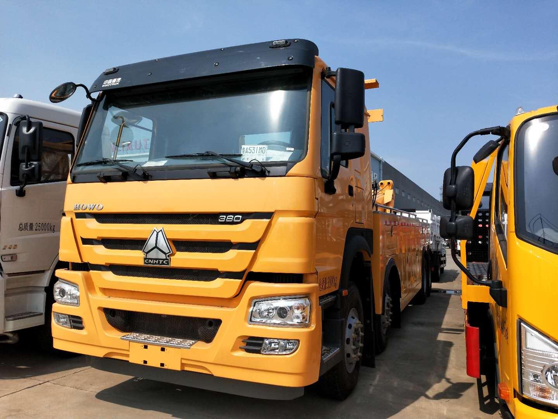 30吨拖车救援车豪沃前四后八大型道路清障车后托臂全伸出操作