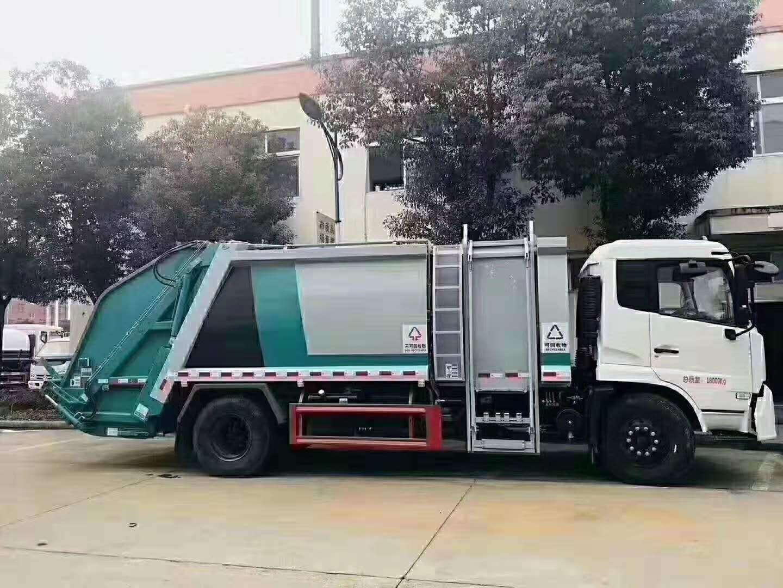 侧装挂桶垃圾车自卸压缩垃圾车挂桶操作视频视频