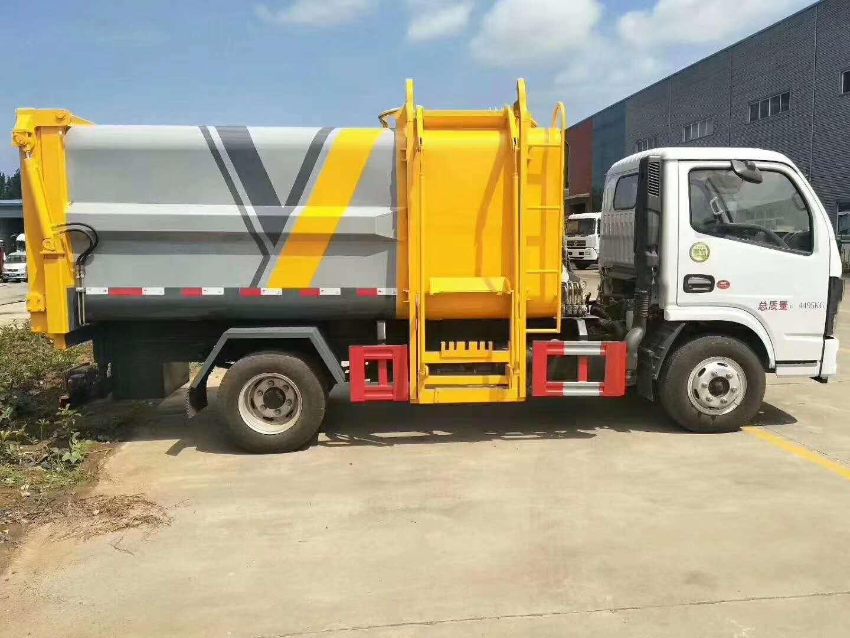 国六小多利卡自装卸式垃圾车高清图片