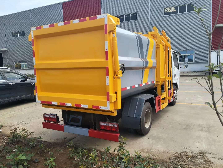 国六东风多利卡5方挂桶垃圾车图片