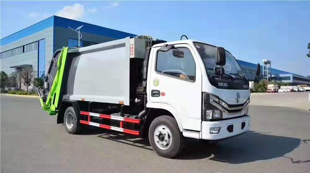 国六3308轴距多利卡D6双向压缩垃圾车