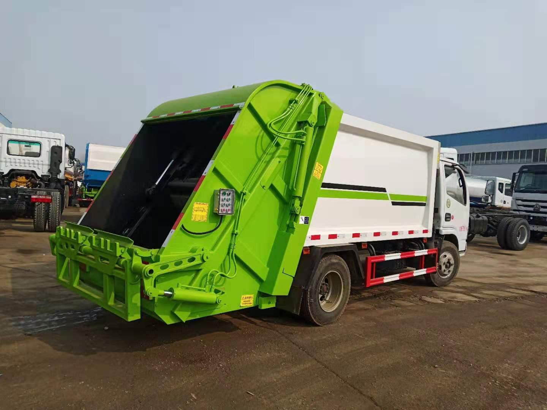 国五东风多利卡6方压缩式垃圾车图片