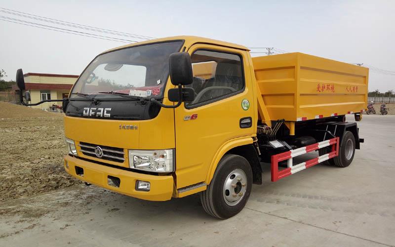 东风多利卡蓝牌5吨勾臂垃圾车多少钱一台?图片