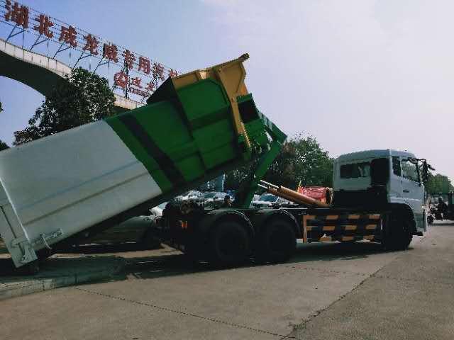 大勾臂垃圾车配套12立方移动垃圾站使用视频图片