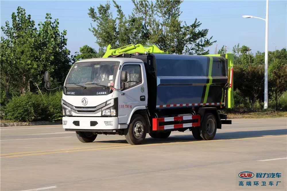 东风国六黄牌侧挂压缩垃圾车图片展示