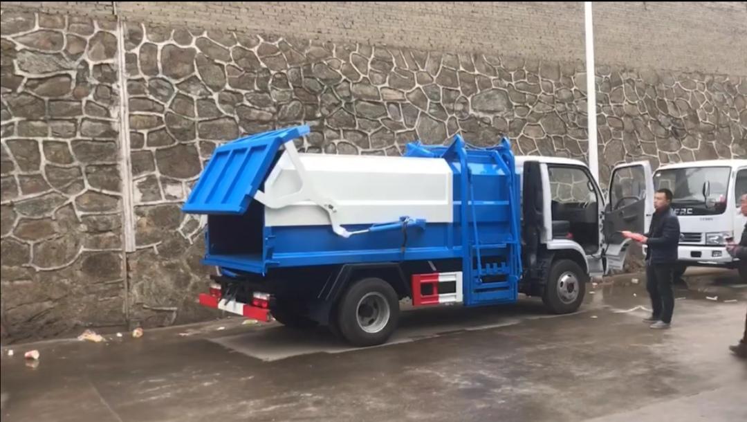 東風藍牌側裝6方壓縮垃圾車掛桶壓縮垃圾車視頻