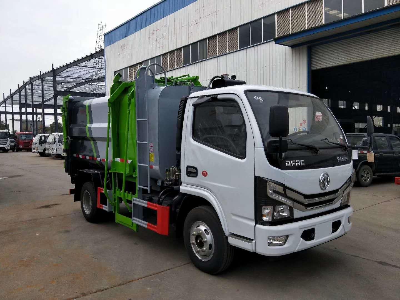 國六東風多利卡側裝壓縮垃圾車圖片