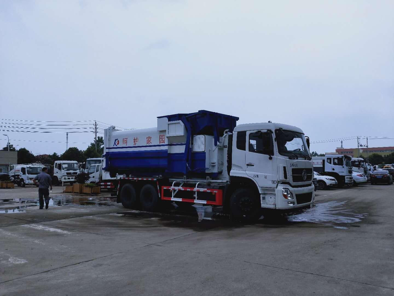 25吨东风天龙后双桥大勾臂垃圾车配套18至20立方移动压缩垃圾站使用视频