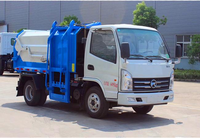 國六7.5方藍牌側裝壓縮垃圾車廠家價格