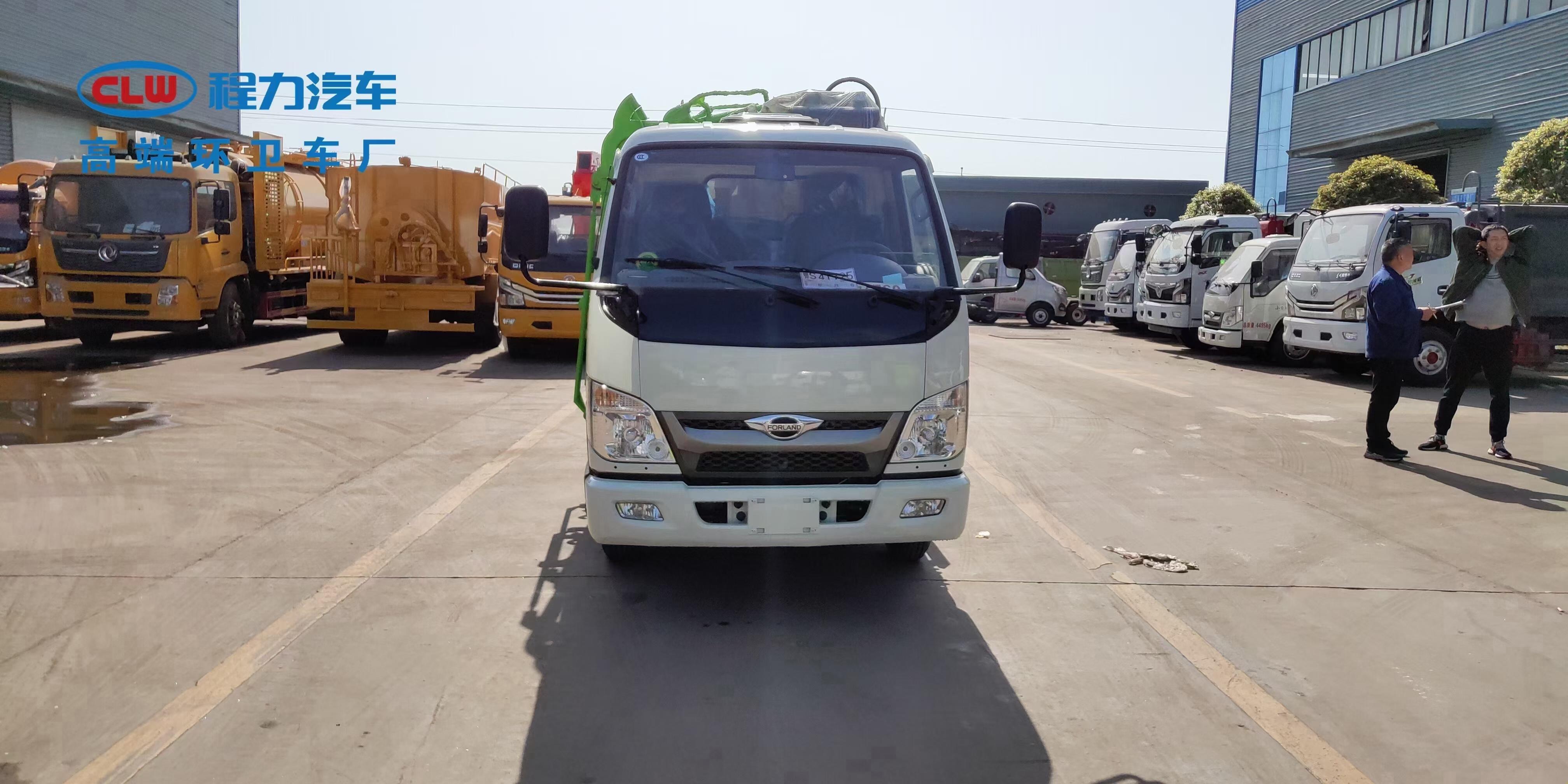 国六福田小卡2侧装压缩挂桶垃圾车图片