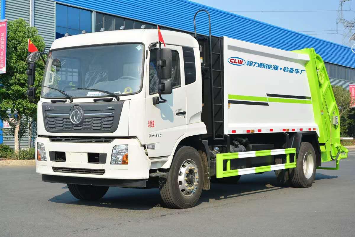 国六14方东风天锦压缩垃圾车厂家康机210马力配套挂桶使用效果图片
