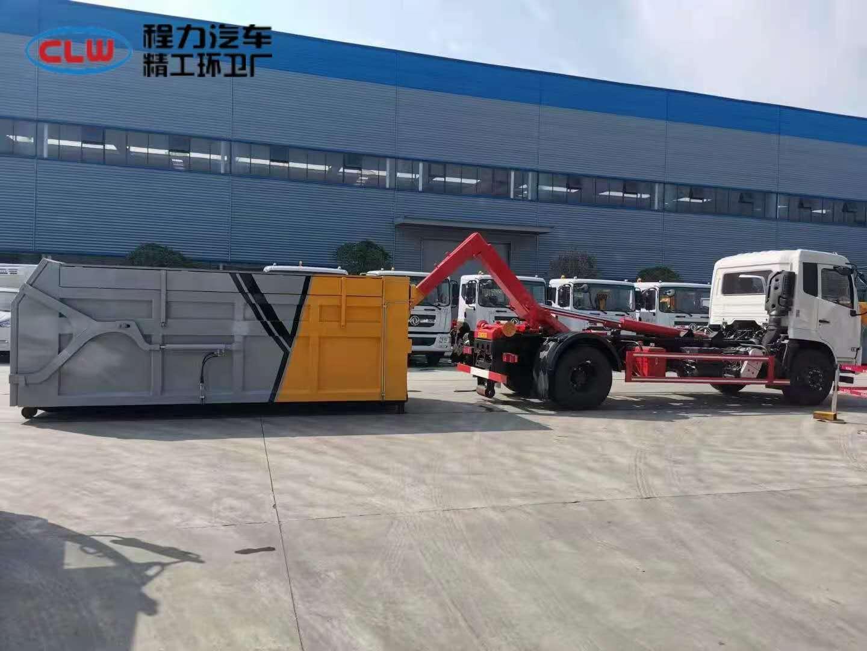 18方东风天锦钩臂车伸缩臂运输垃圾车配20方垃圾箱使用视频图片