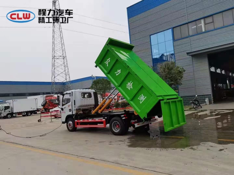 蓝牌建筑垃圾勾臂车配套6方自卸垃圾箱使用作业视频视频