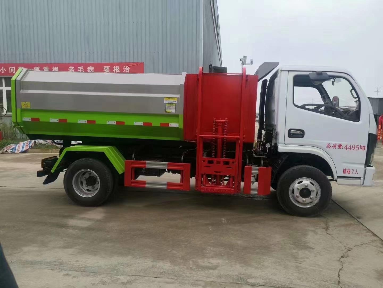 东风7方自装卸式挂桶垃圾车