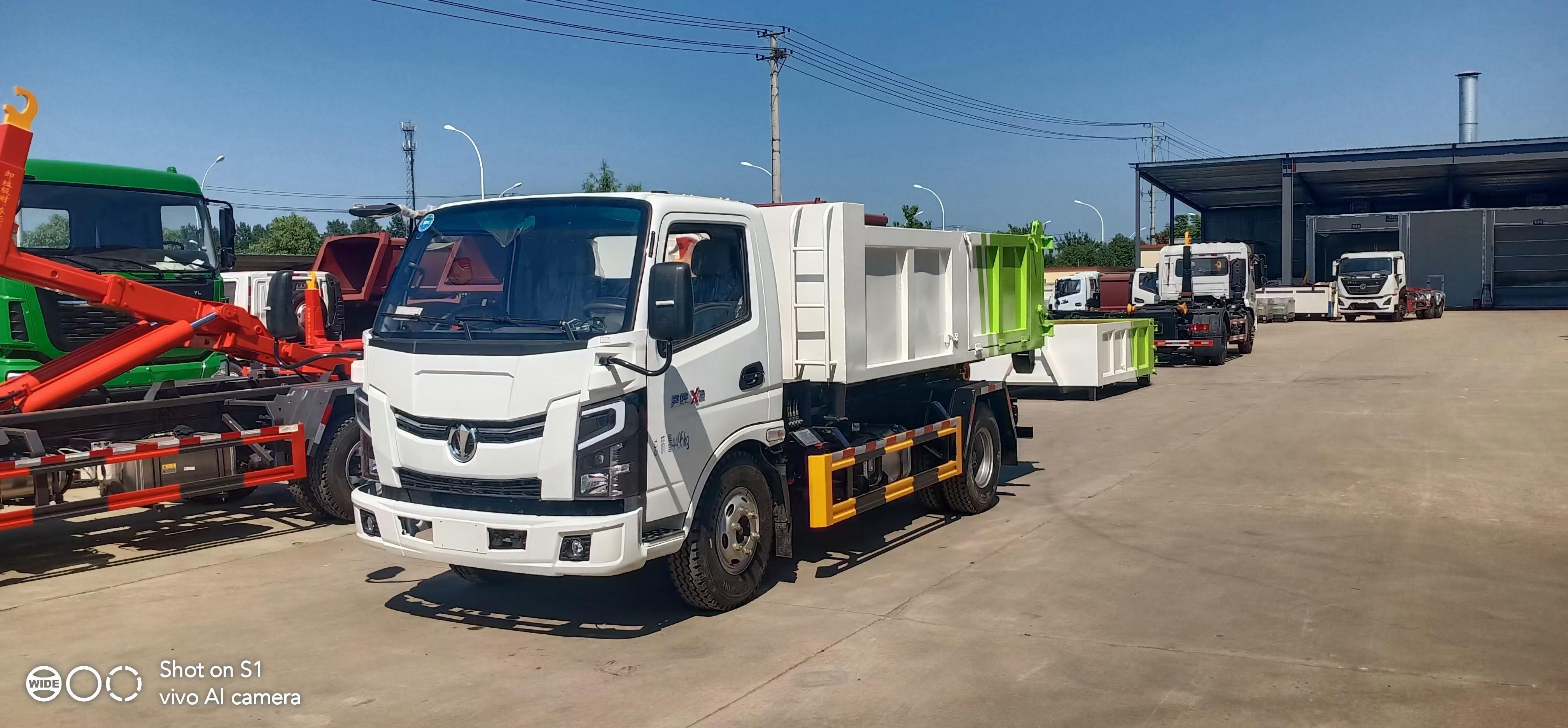 國六藍牌12噸勾臂垃圾車廠家直銷在哪里包送到家圖片
