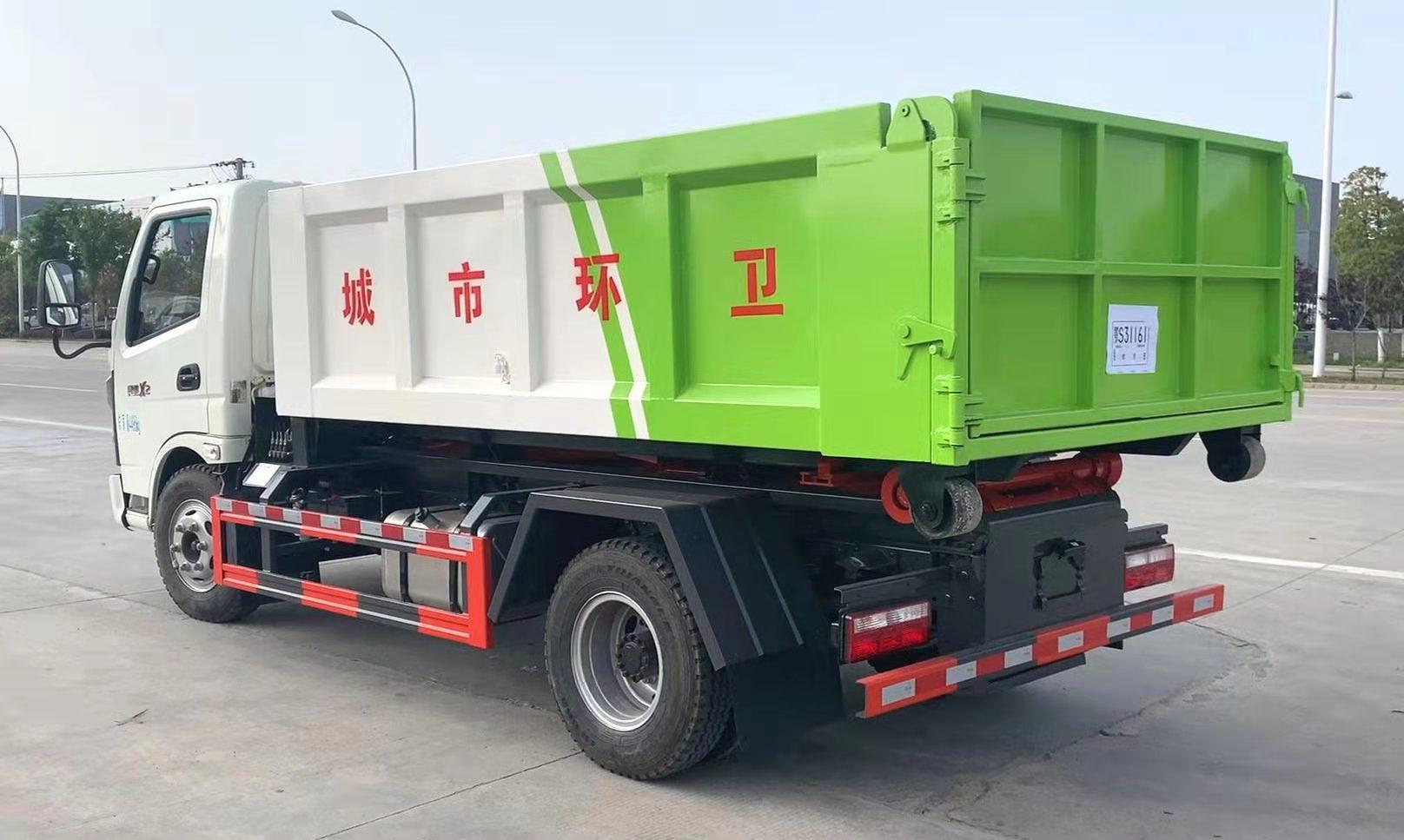建筑垃圾转运车蓝牌钩臂车配置6立方垃圾箱操作视频视频