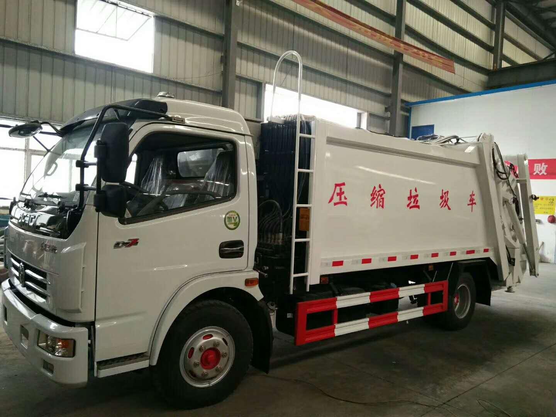 东风多利卡D7 8方压缩垃圾车带3方摆臂垃圾斗图片