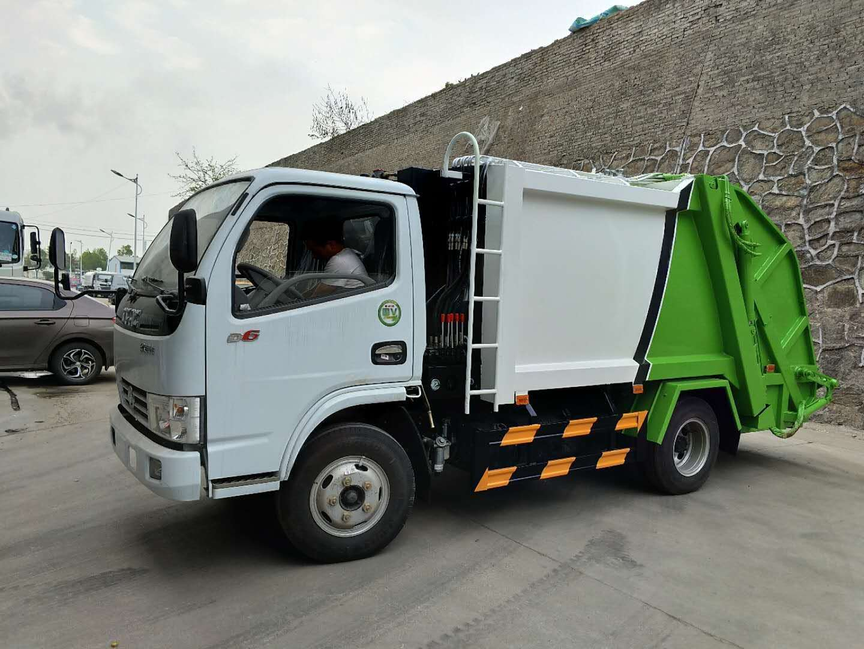 东风多利卡蓝牌5方压缩垃圾车图片