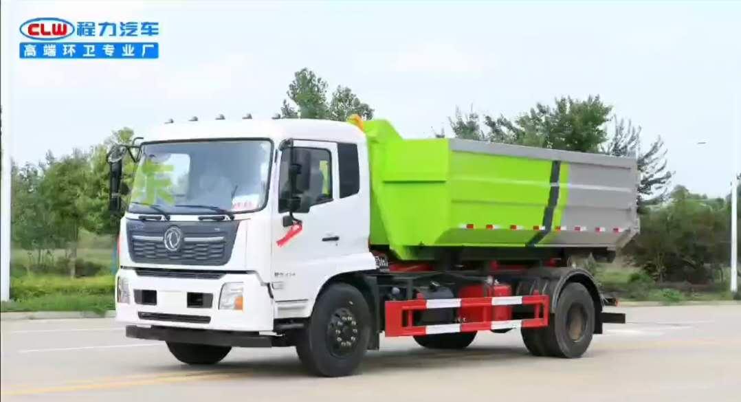 东风天锦勾臂垃圾车托16方建筑垃圾箱操作视频
